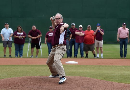 Gene Kasprzyk throws the first pitch in the newly-named Gene Kasprzyk Field, Saturday, March 23, 2019. The Pirates made seven appearances at the state tournament under Kasprzyk.