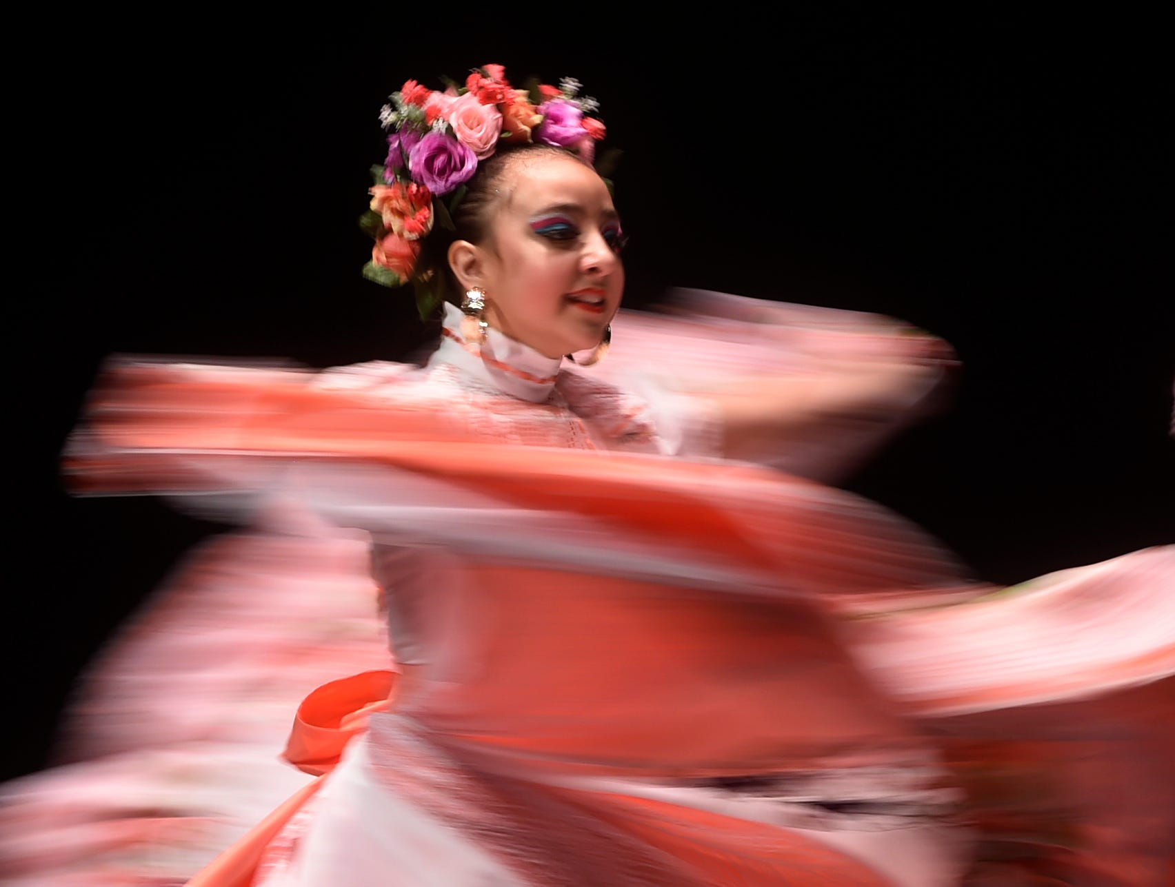 Heleny Mendoza dances during the Alcorta's Compania de danza 7th annual Competencia Folklorica de Tejas at the Selena Auditorium, Saturday, March 23, 2019. Dancers dressed in colorful outfits that represents various regions in Mexico.