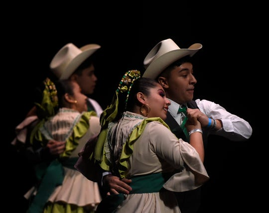 Couples dance at the Competencia Folklorica de Tejas at the Selena Auditorium, Saturday, March 23, 2019. Couples, singles and group performances were judged at the competition.