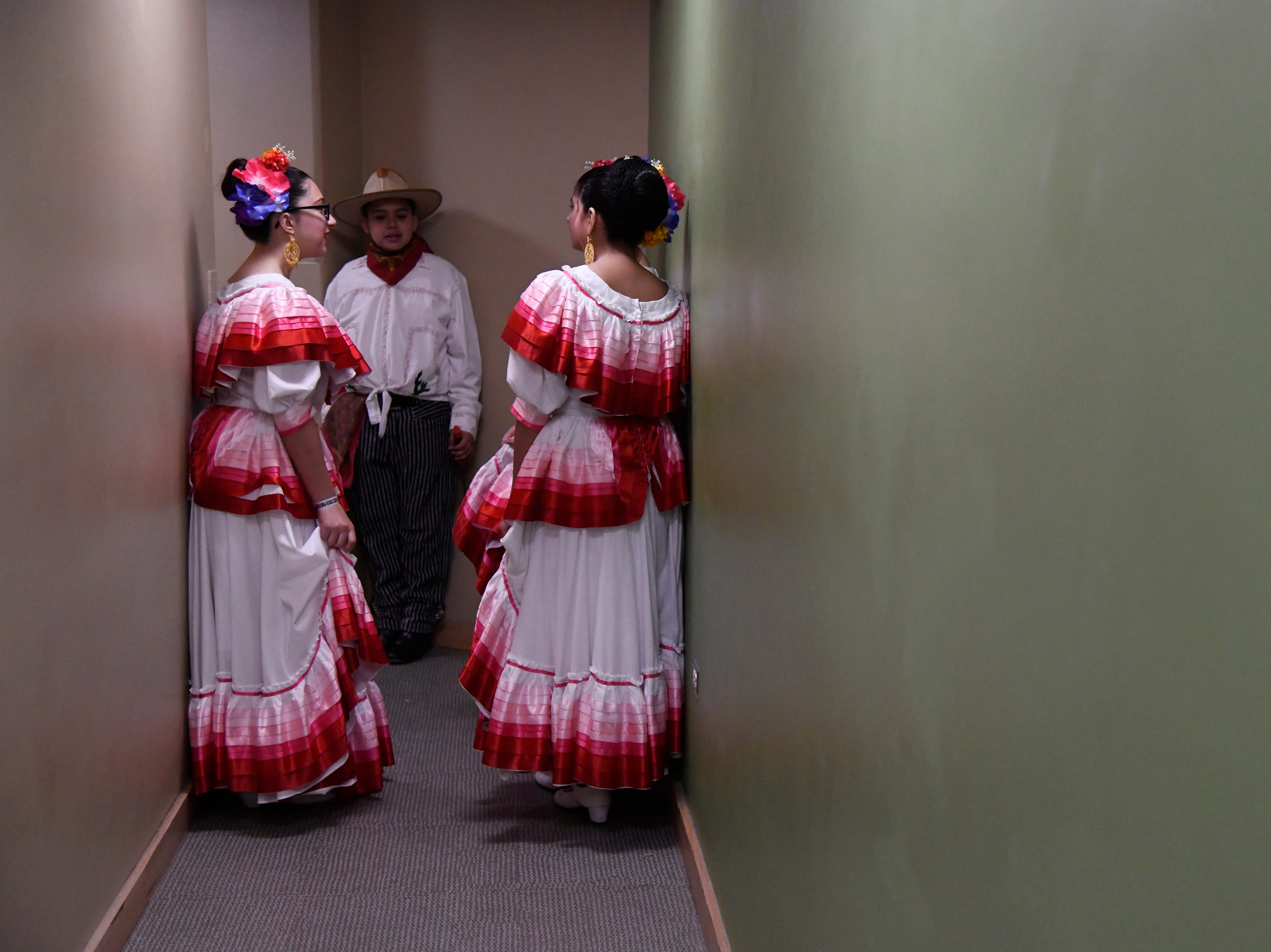 Folklorica dancers wait backstage at the Selena Auditorium, Saturday, March 23, 2019. Dancers from across the country and Mexico competed.