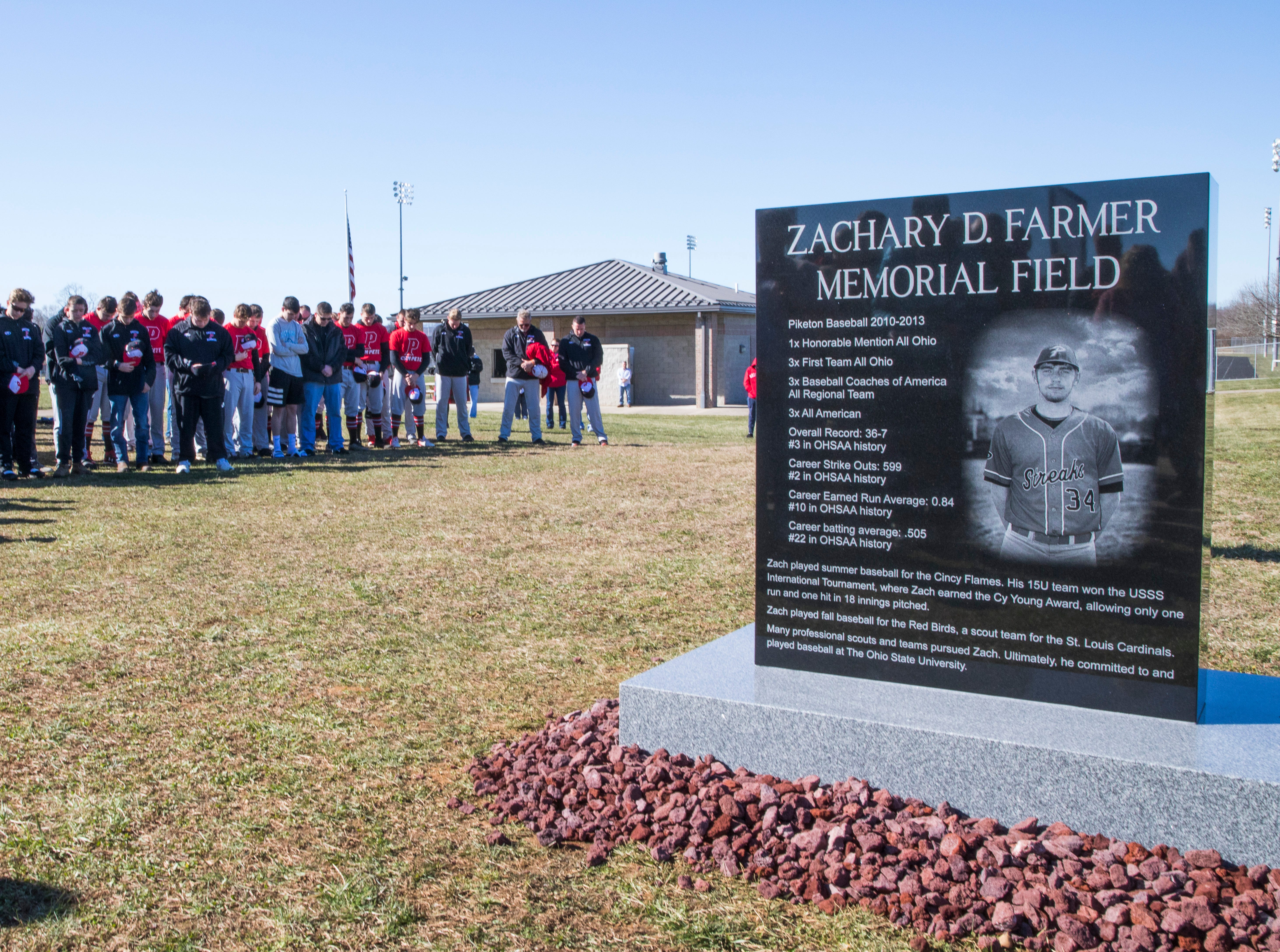 Those in attendance of the Zach Farmer monument dedication prayed in remembrance to honor the former baseball player.