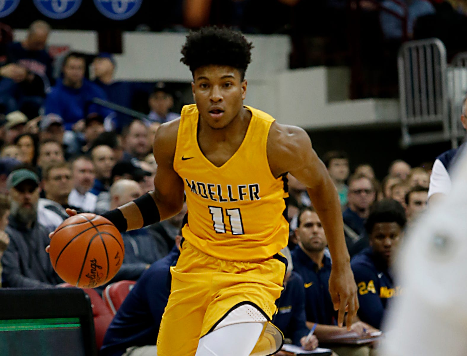 Moeller guard Miles McBride brings the ball upcourt against St. Edward during their Division I semifinal at the Schottenstein Center in Columbus Friday, March 22, 2019.