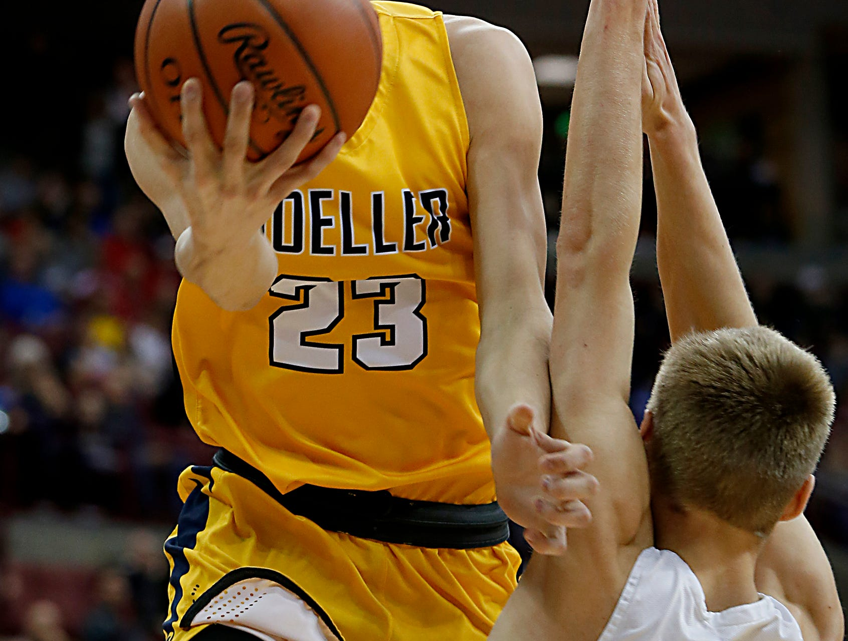Moeller forward Will McCracken drives to the hoop against St. Edward guard Grant Huffman during their Division I semifinal at the Schottenstein Center in Columbus Friday, March 22, 2019.
