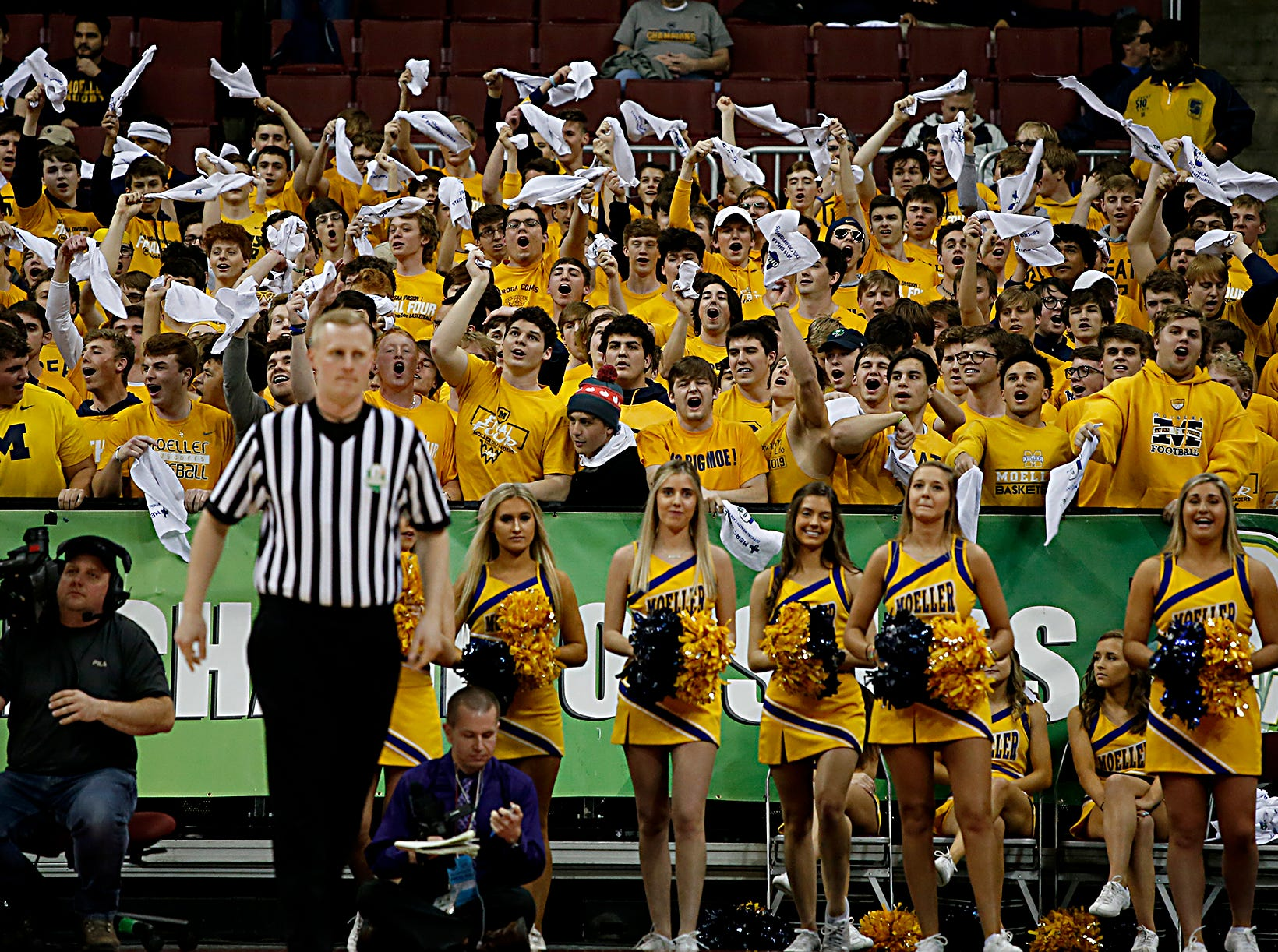 Moeller students wave their towels as their team faces St. Edward in a Division I semifinal at the Schottenstein Center in Columbus Friday, March 22, 2019.