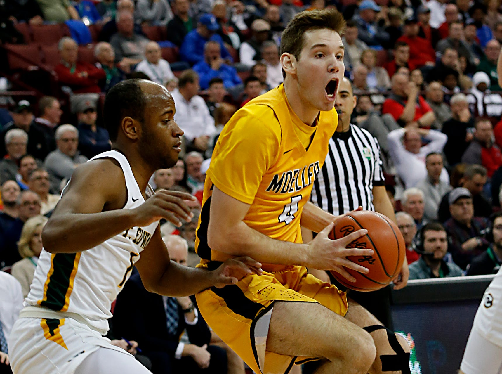 Moeller forward Michael Shipp is covered by St. Edward guard Demetrius Terry during their Division I semifinal at the Schottenstein Center in Columbus Friday, March 22, 2019.