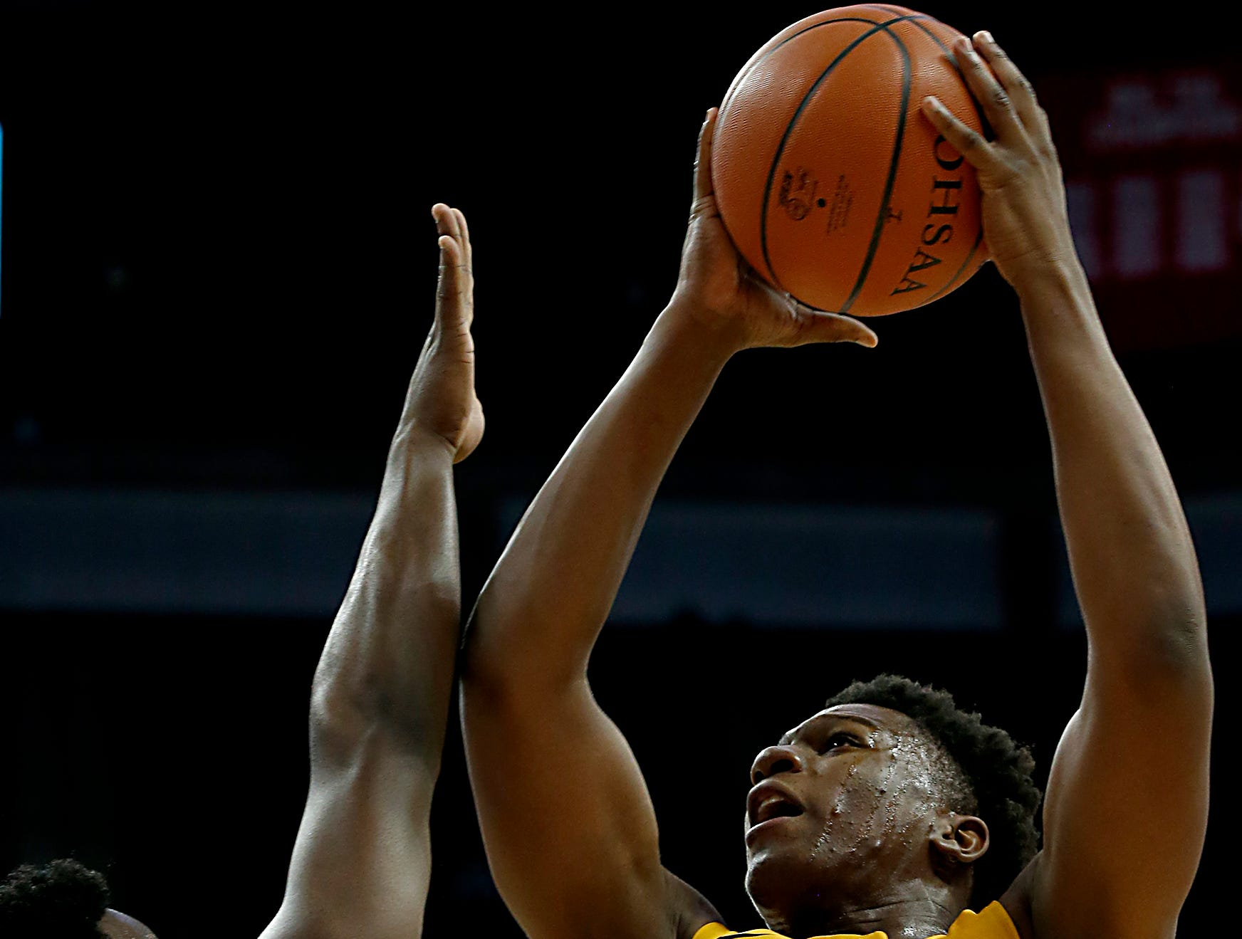 Moeller forward Alex Williams gets the basket and the foul from St. Edward guard/forward Devontae Blanton during their Division I semifinal at the Schottenstein Center in Columbus Friday, March 22, 2019.