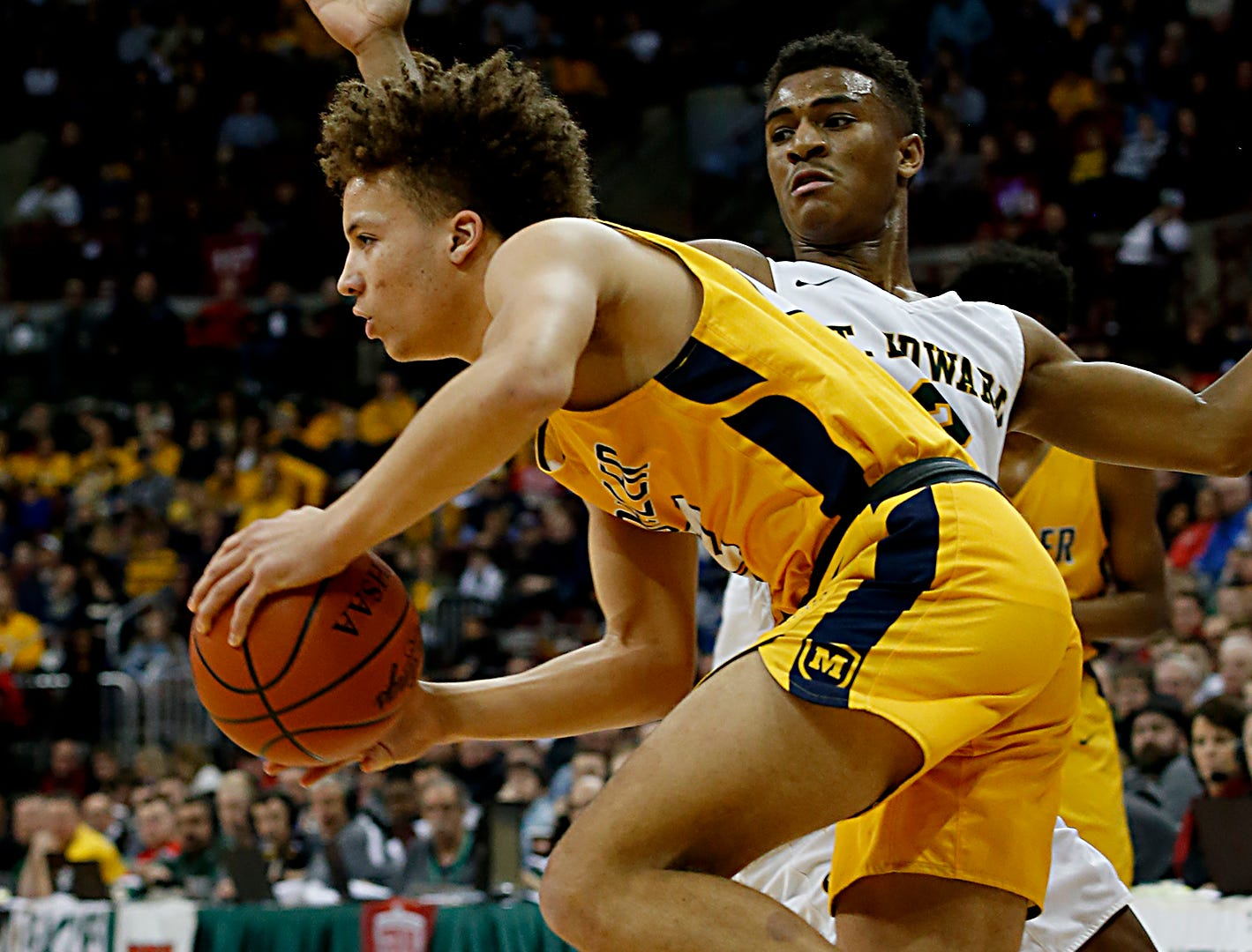 Moeller forward Max Land escapes St. Edward guard Montorie Foster during their Division I semifinal at the Schottenstein Center in Columbus Friday, March 22, 2019.