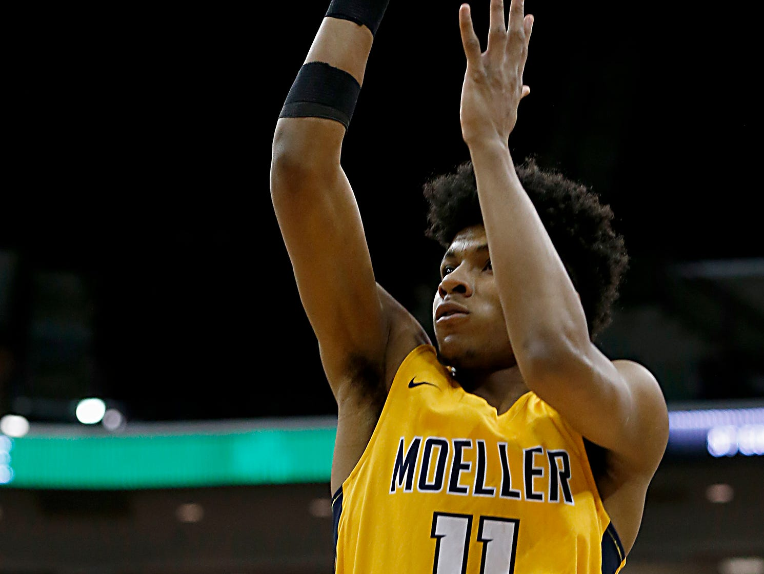 Moeller guard Miles McBride hits for two against St. Edward during their Division I semifinal at the Schottenstein Center in Columbus Friday, March 22, 2019.