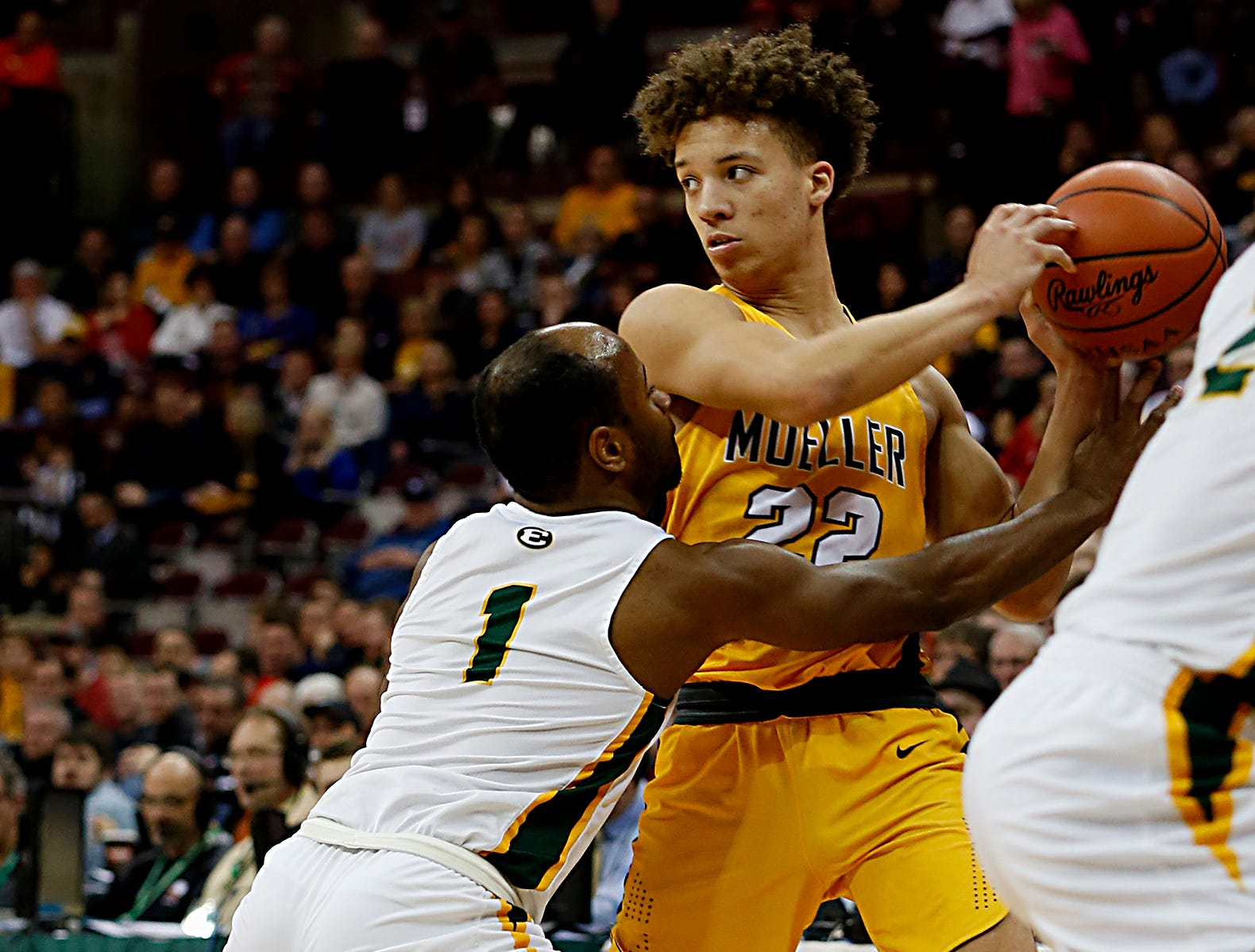 Moeller forward Max Land is pressured by St. Edward guard Demetrius Terry during their Division I semifinal at the Schottenstein Center in Columbus Friday, March 22, 2019.