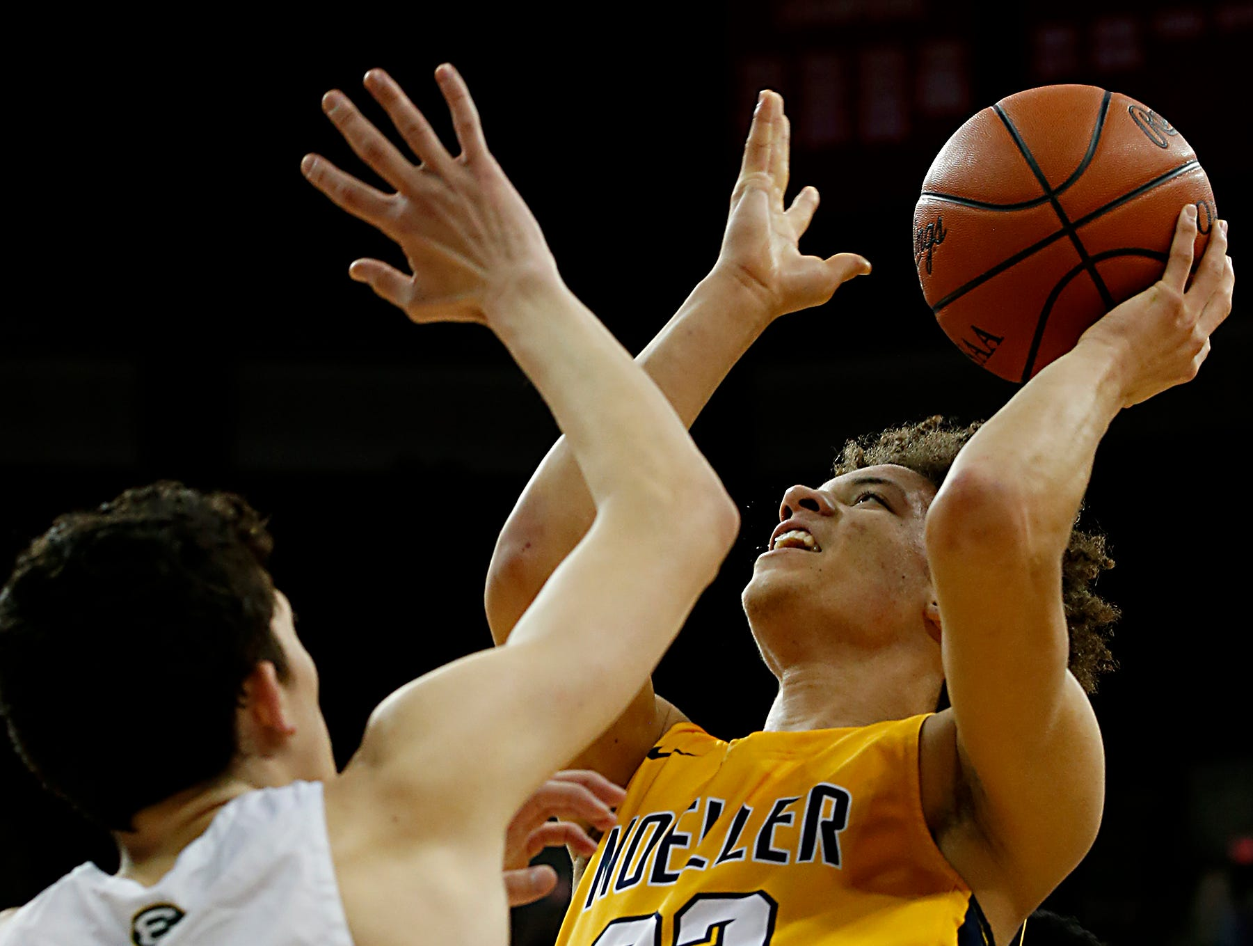 Moeller forward Max Land scores two against St. Edward guard Josh Ogle during their Division I semifinal at the Schottenstein Center in Columbus Friday, March 22, 2019.