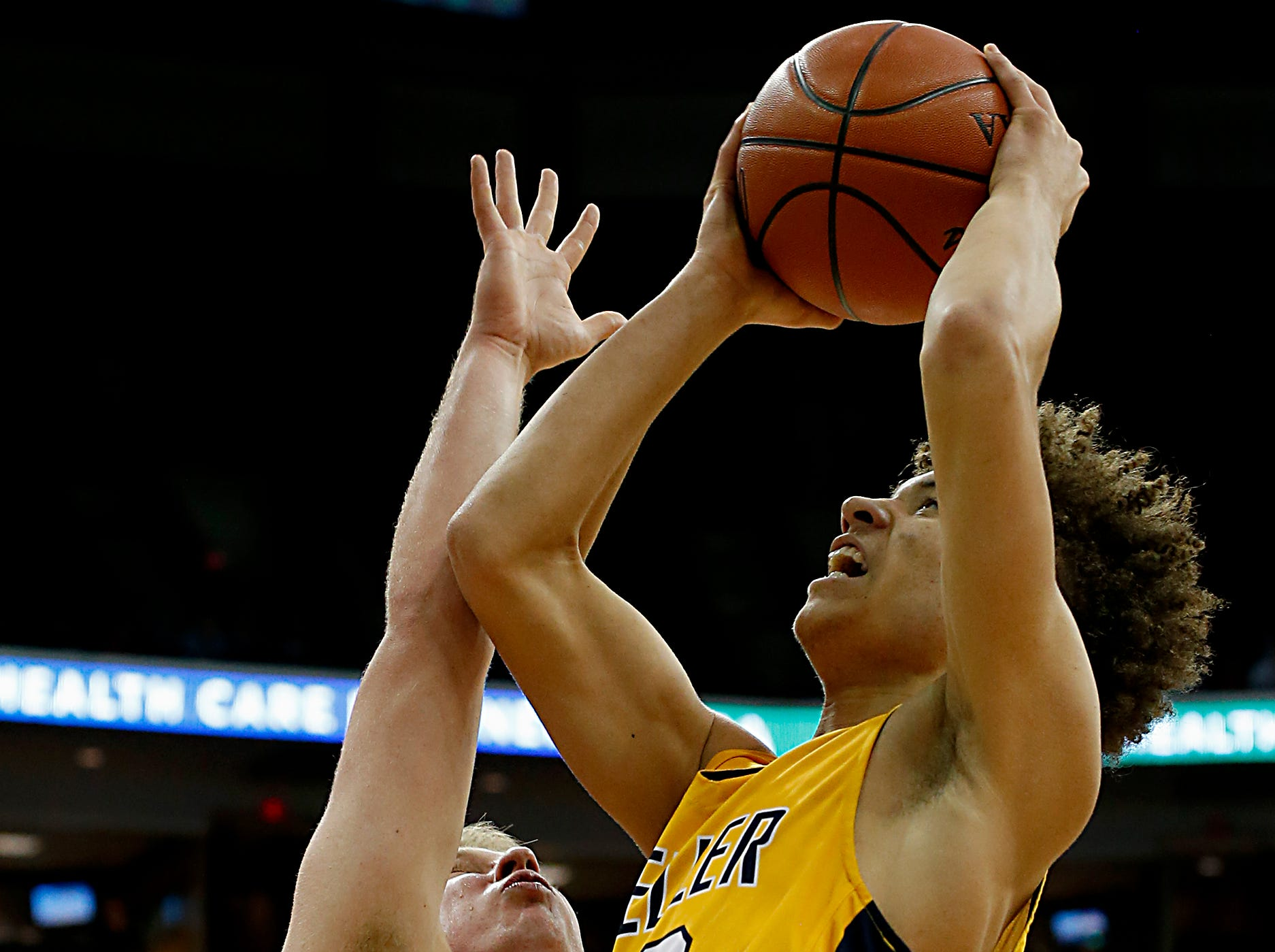 Moeller forward Max Land gets the basket and the foul from St. Edward center Spencer Crane during their Division I semifinal at the Schottenstein Center in Columbus Friday, March 22, 2019.