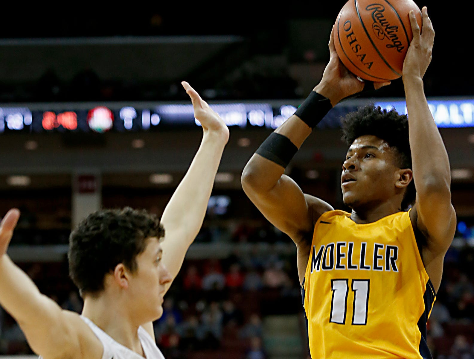 Moeller guard Miles McBride goes to the basket against St. Edward guard Josh Ogle during their Division I semifinal at the Schottenstein Center in Columbus Friday, March 22, 2019.