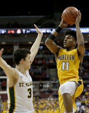 Moeller guard Miles McBride goes to the basket against St. Edward guard Josh Ogle during their Division 1 semifinal at the Schottenstein Center in Columbus Friday, March 22, 2019.