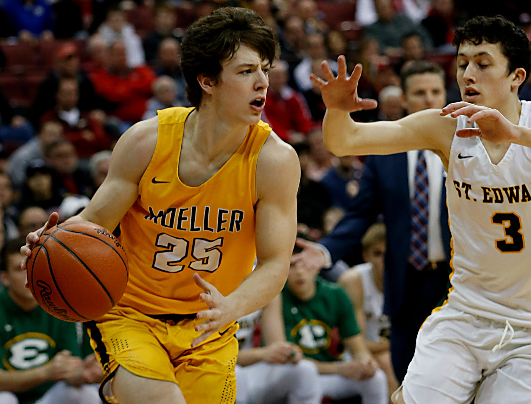 Moeller forward Michael Currin drives against St. Edward guard Josh Ogle during their Division I semifinal at the Schottenstein Center in Columbus Friday, March 22, 2019.