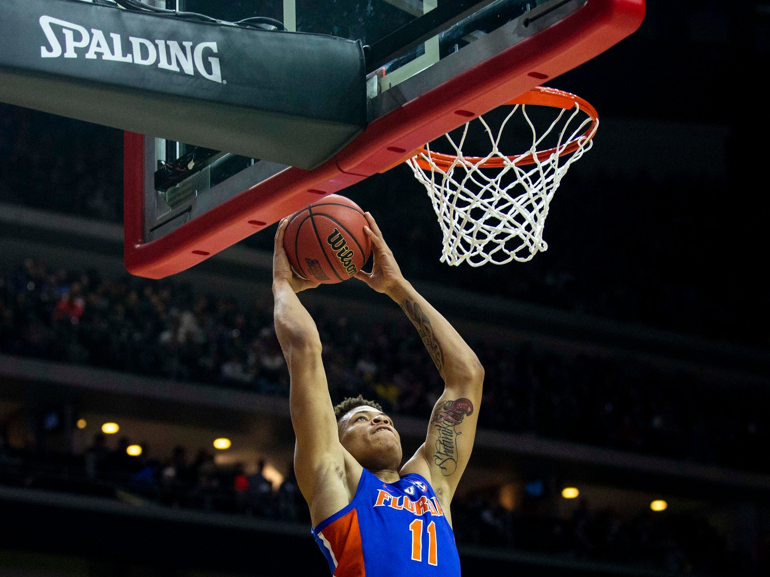 Florida's Keyontae Johnson dunks the ball during the NCAA Tournament second-round match-up between Michigan and Florida on Saturday, March 23, 2019, in Wells Fargo Arena in Des Moines, Iowa.