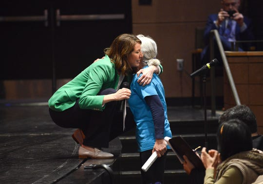 U.S. Rep. Cindy Axne, a Democrat representing Iowa's 3rd Congressional District, hugs a community member Saturday, March 23, 2019, at her first town hall at Valley High School in West Des Moines.