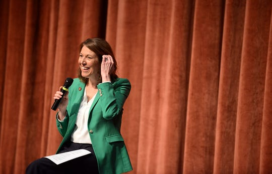 U.S. Rep. Cindy Axne, a Democrat representing Iowa's 3rd Congressional District, speaks to community members Saturday, March 23, 2019, during her first town hall at Valley High School in West Des Moines.