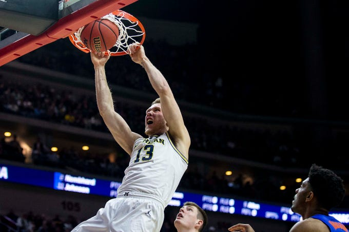 Michigan's Ignas Brazdeikis dunks the ball during the NCAA Tournament second-round match-up between Michigan and Florida on Saturday, March 23, 2019, in Wells Fargo Arena in Des Moines, Iowa.