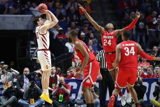 Mar 22, 2019; Tulsa, OK, USA; Iowa State Cyclones forward Michael Jacobson (12) shoots against Ohio State Buckeyes forward Andre Wesson (24) and forward Kaleb Wesson (34) during the first half in the first round of the 2019 NCAA Tournament at BOK Center.