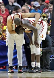 Iowa State's Talen Horton-Tucker, left, consoles teammate Marial Shayok after losing to Ohio State in a first round men's college basketball game in the NCAA Tournament Friday, March 22, 2019, in Tulsa, Okla. Ohio State won 62-59.