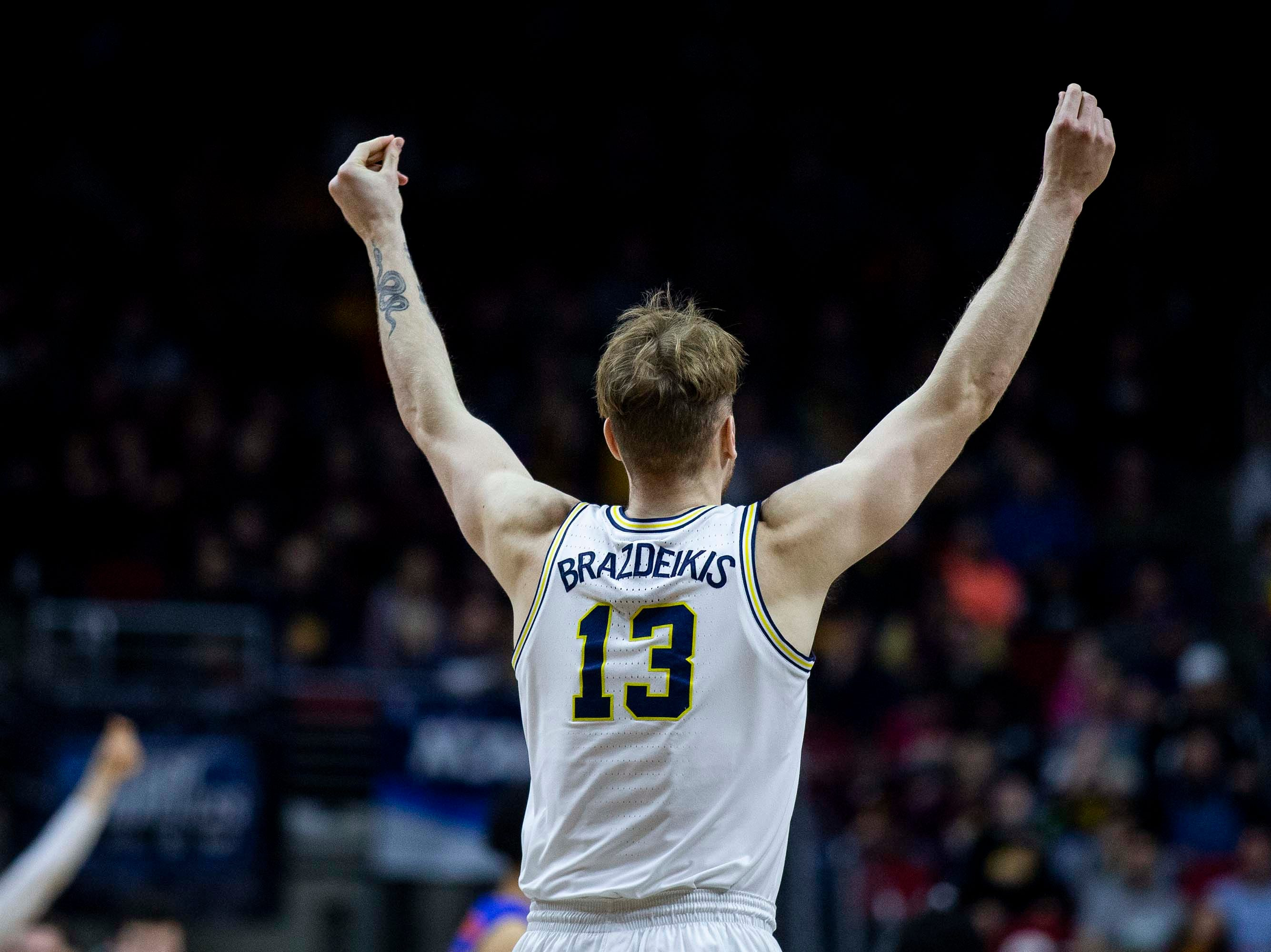 Michigan's Ignas Brazdeikis celebrates after scoring during the NCAA Tournament second-round match-up between Michigan and Florida on Saturday, March 23, 2019, in Wells Fargo Arena in Des Moines, Iowa.