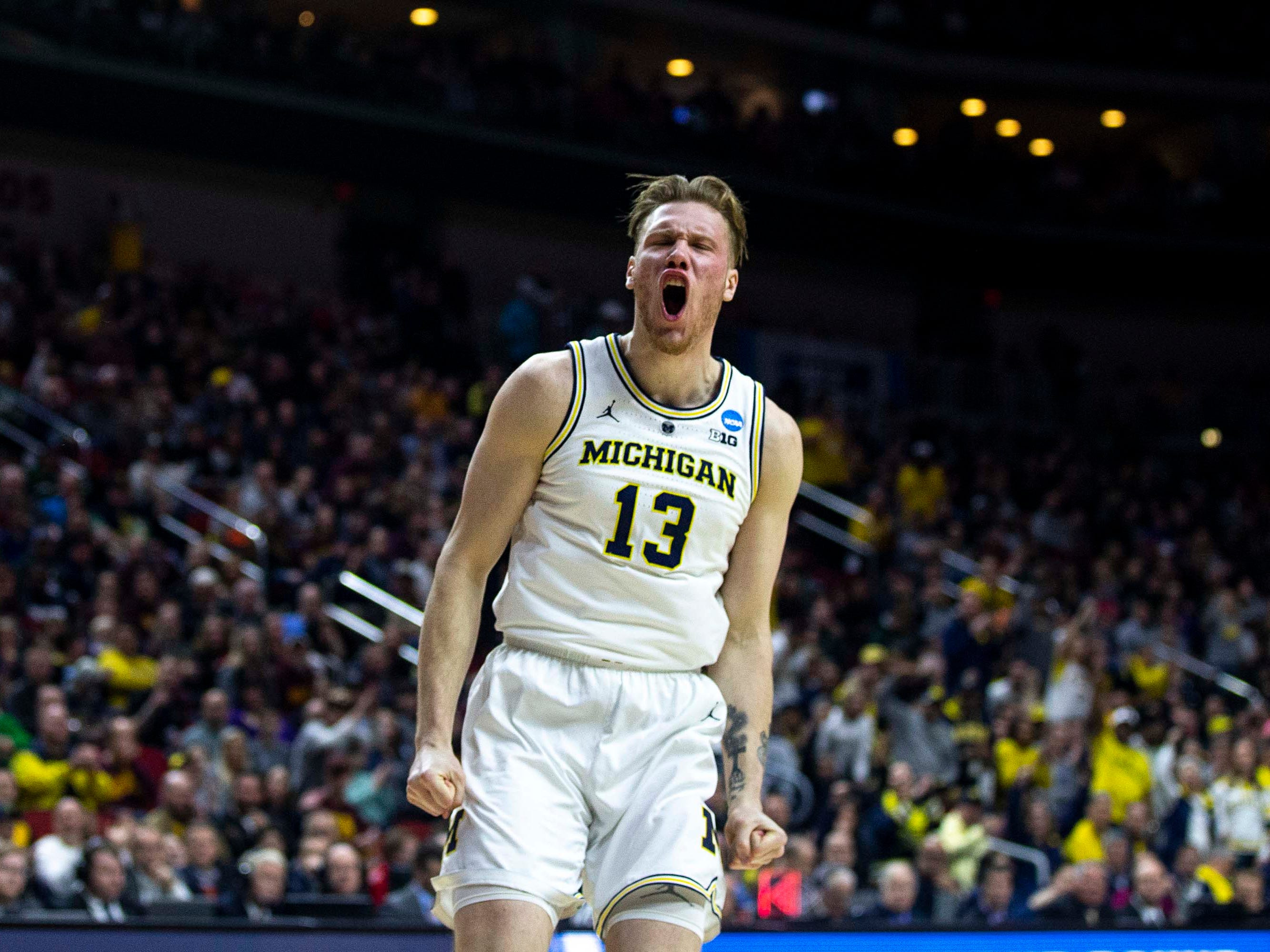 Michigan's Ignas Brazdeikis celebrates after making a dunk during the NCAA Tournament second-round match-up between Michigan and Florida on Saturday, March 23, 2019, in Wells Fargo Arena in Des Moines, Iowa.