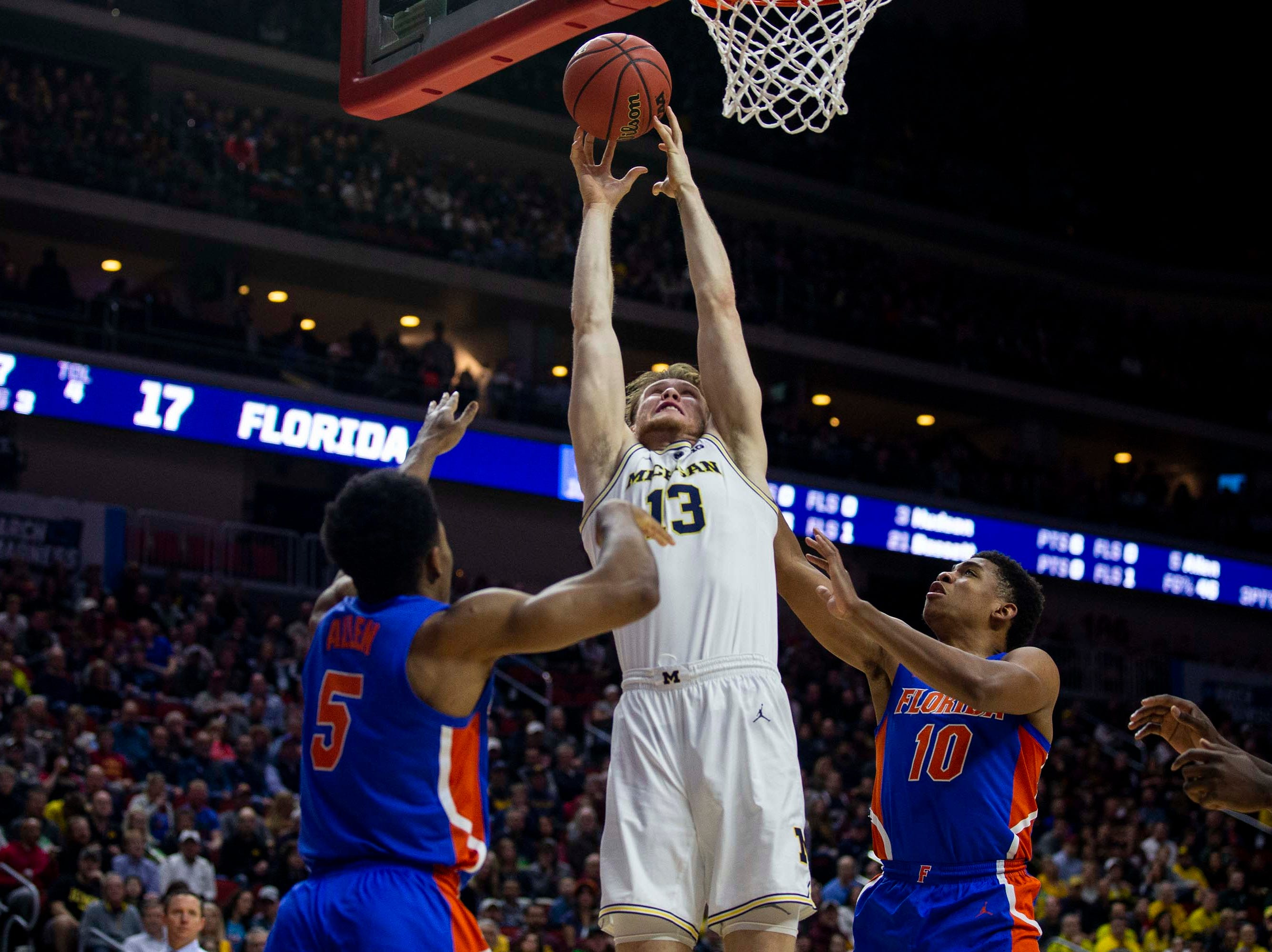 Michigan's Ignas Brazdeikis shoots the ball during the NCAA Tournament second-round match-up between Michigan and Florida on Saturday, March 23, 2019, in Wells Fargo Arena in Des Moines, Iowa.