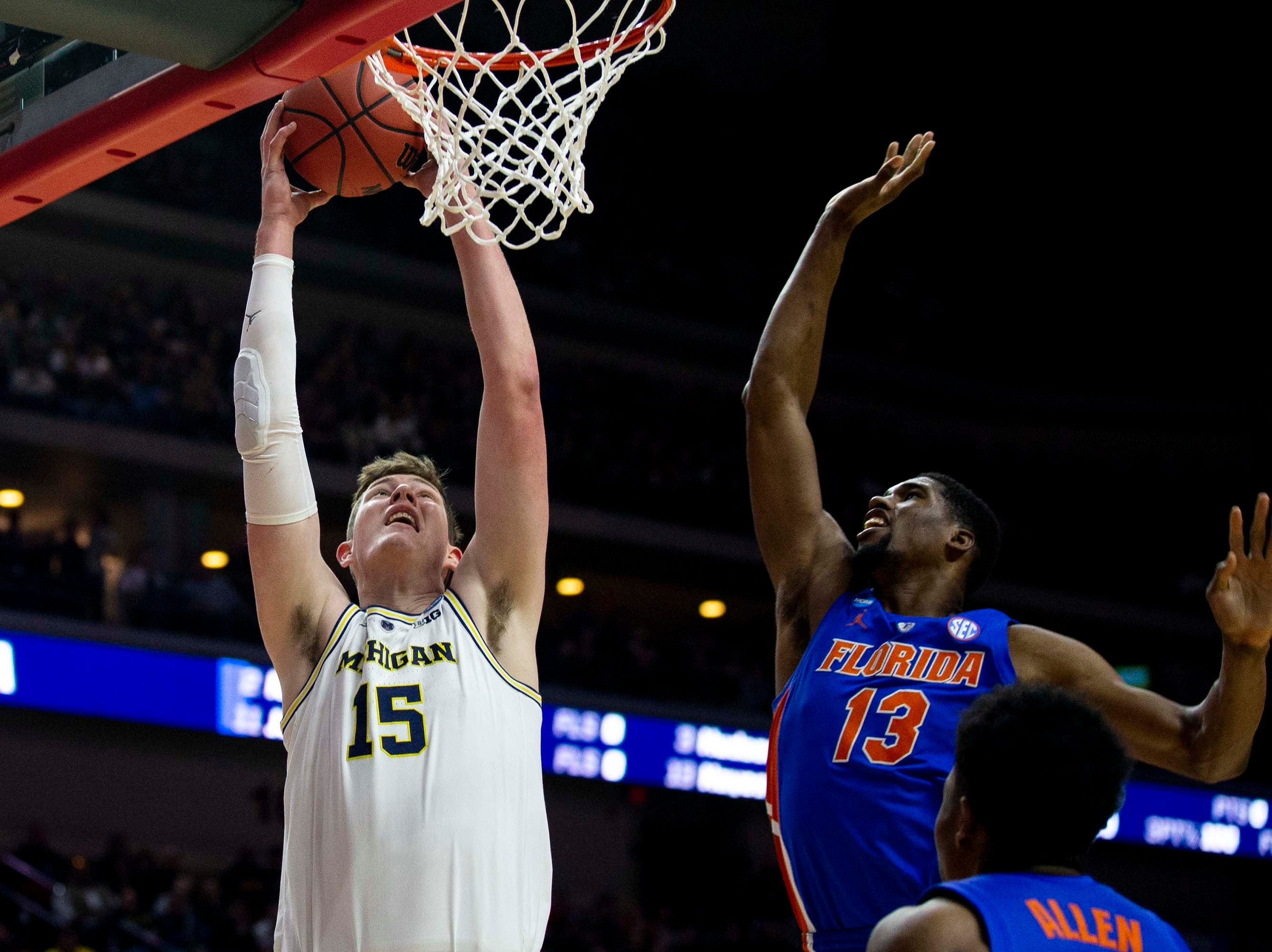 Michigan's Jon Teske dunks during the NCAA Tournament second-round match-up between Michigan and Florida on Saturday, March 23, 2019, in Wells Fargo Arena in Des Moines, Iowa.