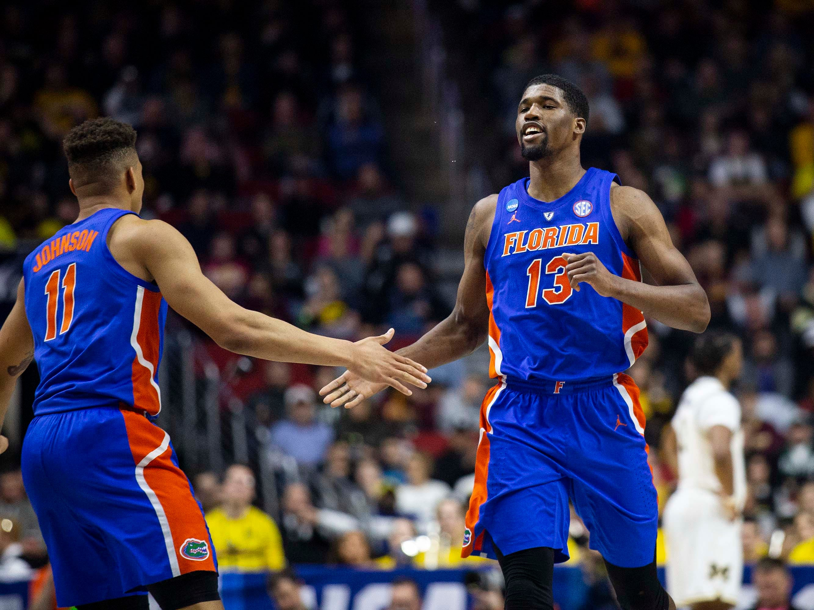 Florida's Keyontae Johnson and Florida's Kevarrius Hayes give each other five after scoring on the previous play during the NCAA Tournament second-round match-up between Michigan and Florida on Saturday, March 23, 2019, in Wells Fargo Arena in Des Moines, Iowa.
