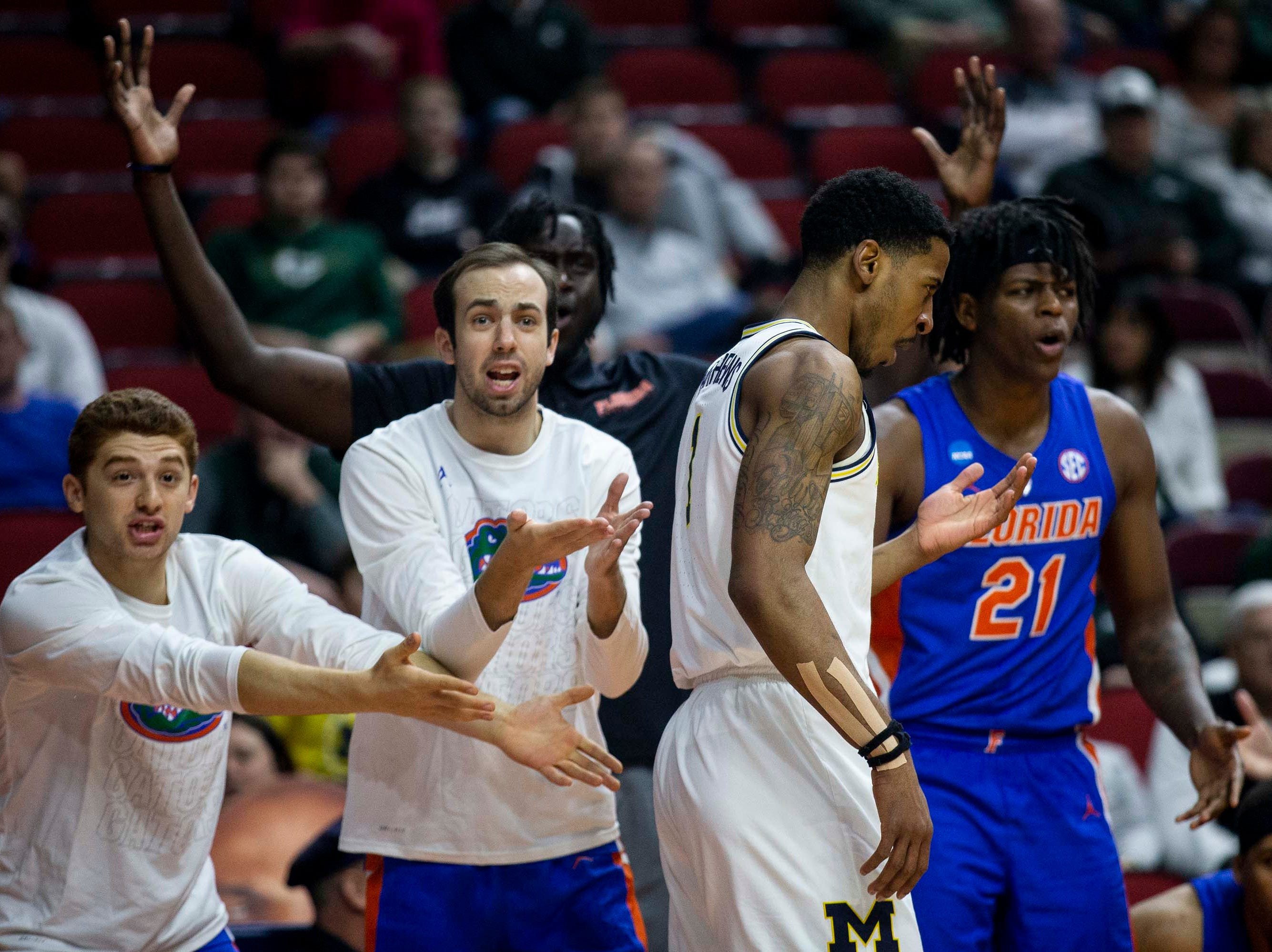 Florida players react to a call during the NCAA Tournament second-round match-up between Michigan and Florida on Saturday, March 23, 2019, in Wells Fargo Arena in Des Moines, Iowa.