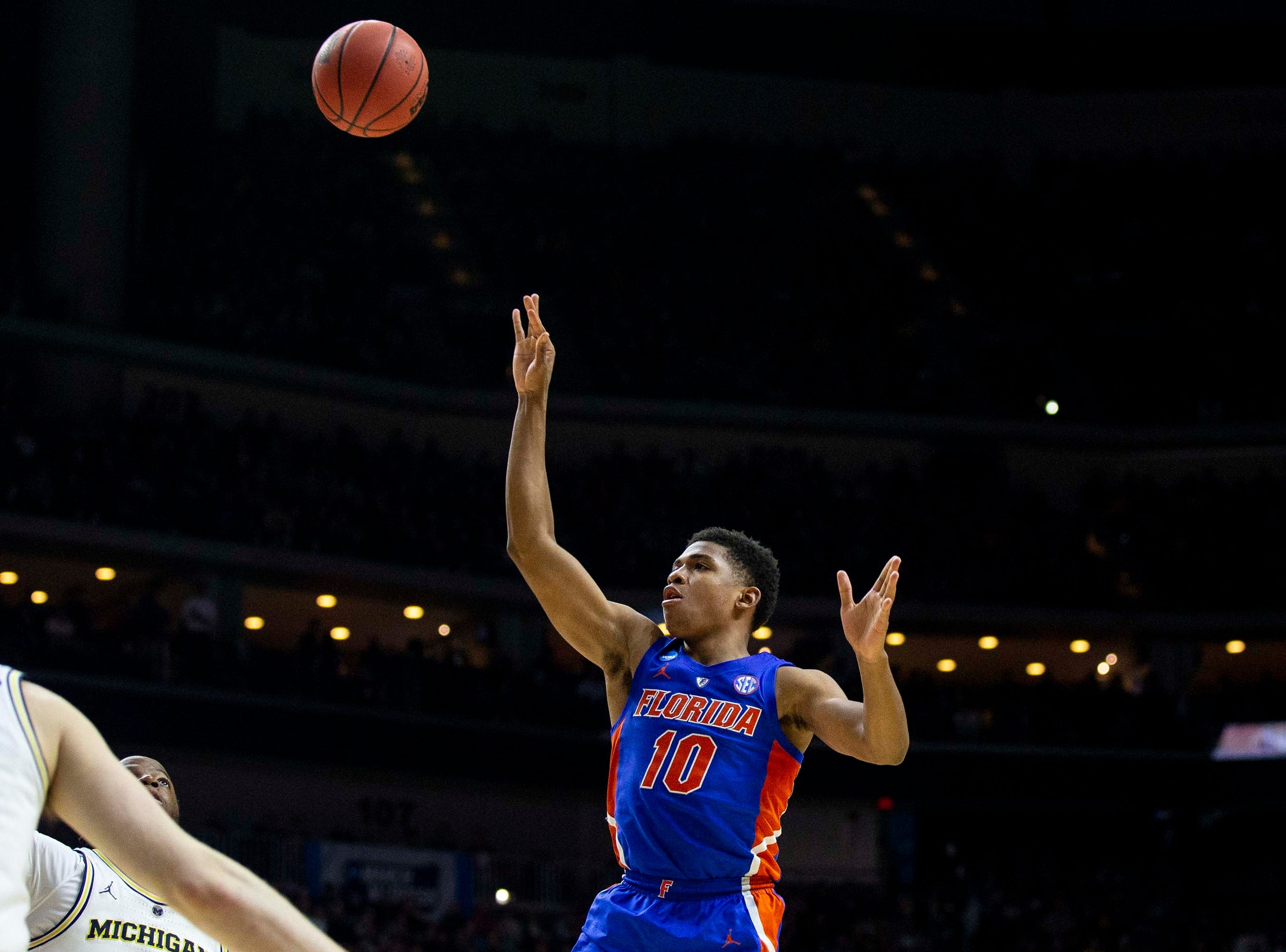 Florida's Noah Locke shoots the ball during the NCAA Tournament second-round match-up between Michigan and Florida on Saturday, March 23, 2019, in Wells Fargo Arena in Des Moines, Iowa.