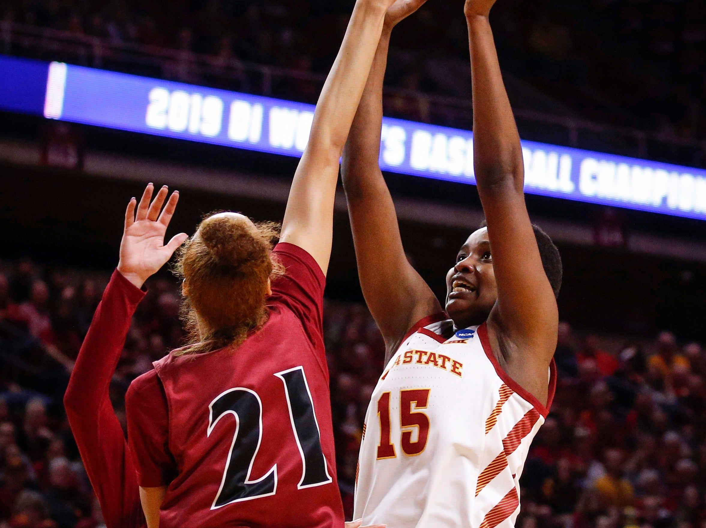 Iowa State senior Ines Nezerwa puts up a shot over New Mexico State senior Monique Mills on Saturday, March 23, 2019, at Hilton Coliseum in Ames.