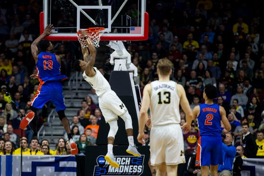 Michigan's Charles Matthews dunks the ball during the NCAA Tournament second-round match-up between Michigan and Florida on Saturday, March 23, 2019, in Wells Fargo Arena in Des Moines, Iowa.