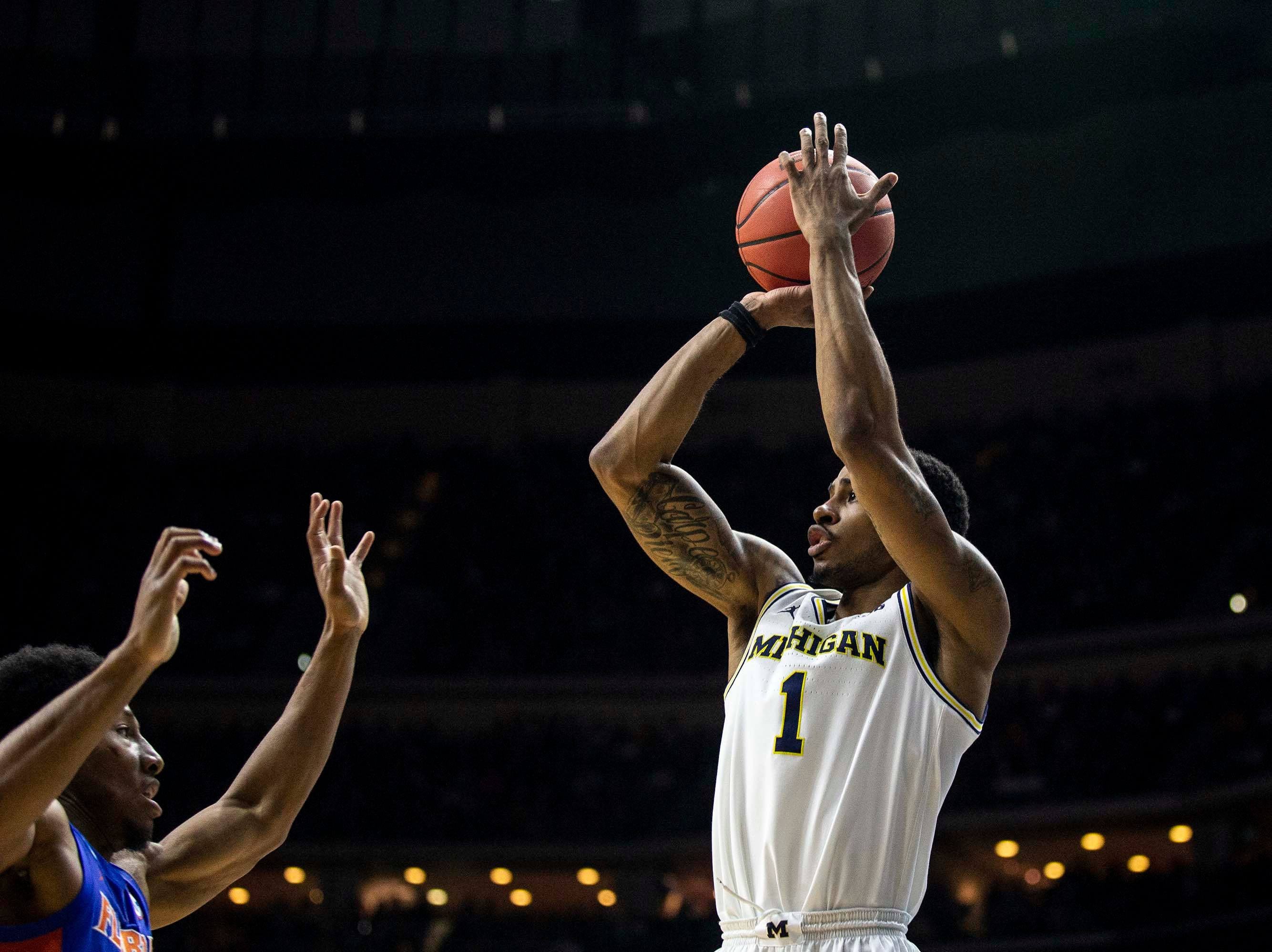 Michigan's Charles Matthews shoots the ball during the NCAA Tournament second-round match-up between Michigan and Florida on Saturday, March 23, 2019, in Wells Fargo Arena in Des Moines, Iowa.