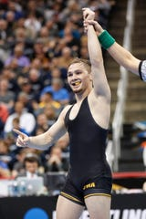 Iowa's Spencer Lee celebrates defeating Oklahoma State's Nicholas Piccinni in their 125-pound match in the semifinals of the NCAA wrestling championships, Friday, March 22, 2019, in Pittsburgh. Lee faces Virginia's Jack Mueller for the championship Saturday.