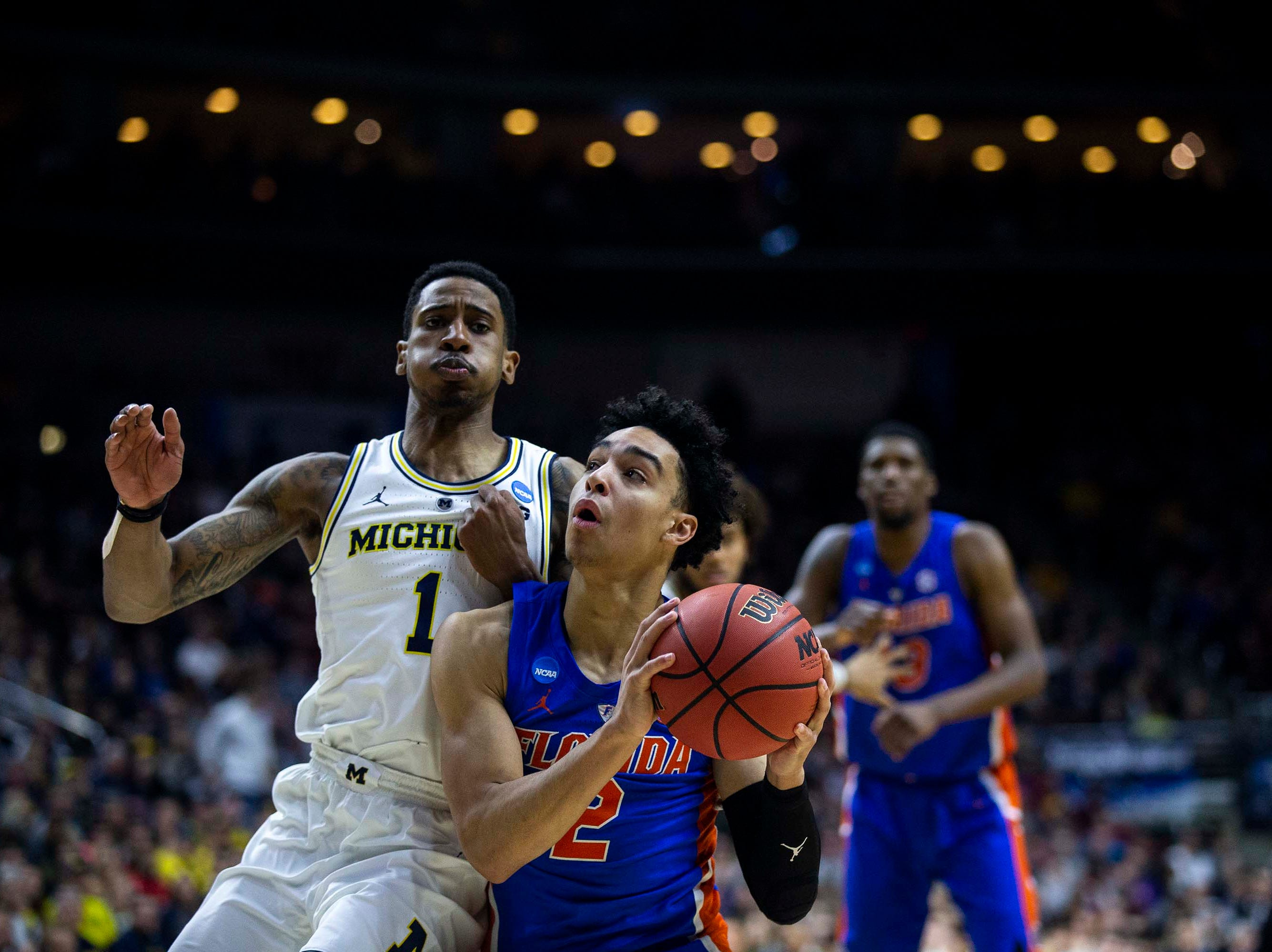 Florida's Andrew Nembhard drives to the hoop during the NCAA Tournament second-round match-up between Michigan and Florida on Saturday, March 23, 2019, in Wells Fargo Arena in Des Moines, Iowa.