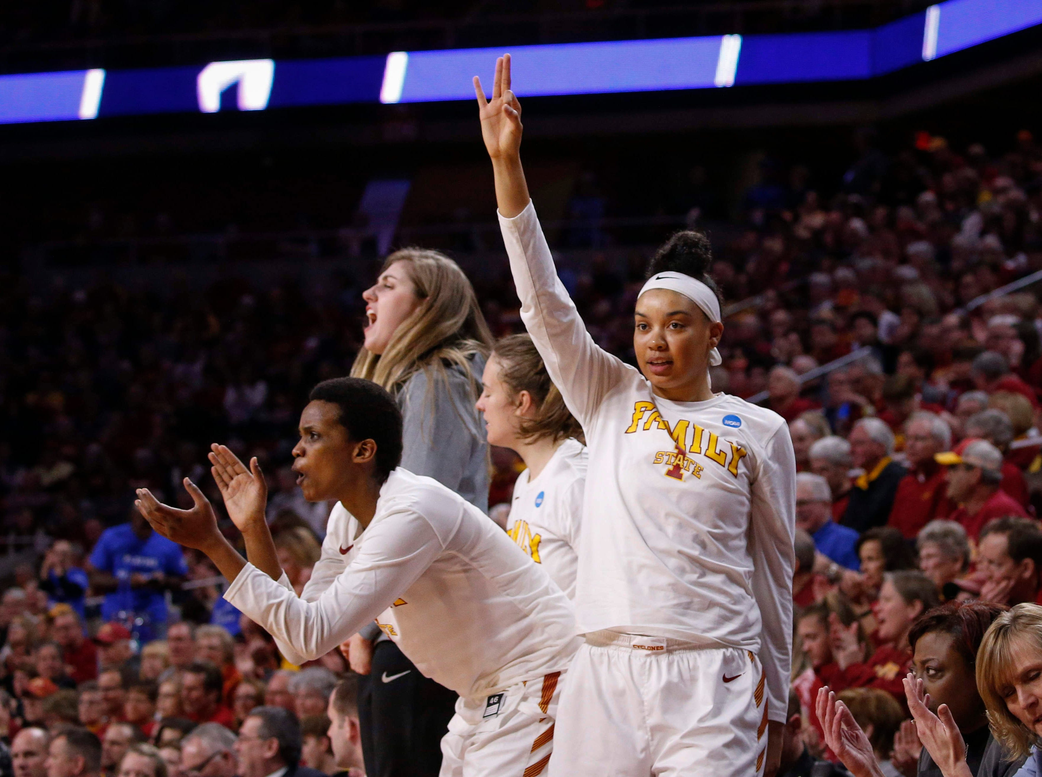 Members of the Iowa State women's basketball team cheer after teammate Bridget Carleton hit a three-pointer against New Mexico State on Saturday, March 23, 2019, at Hilton Coliseum in Ames.