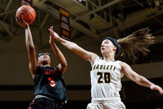 Detroit Edison's Gabrielle Elliott (3) makes a layup against Haslett's Skyla Nosek (20 during the first half of MHSAA girls Division 2 semifinal at Van Noord Arena in Grand Rapids, Friday, March 22, 2019.