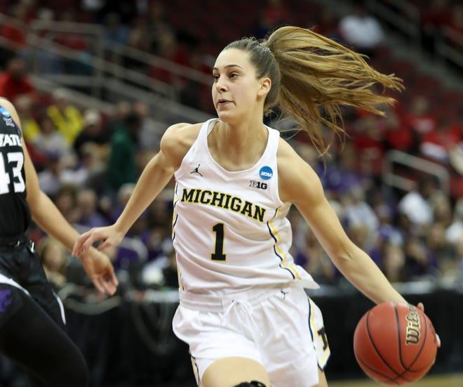 Michigan's Amy Dilk drives the ball around Kansas State's Chrstianna Carr in the first round of the Women's NCAA Tournament in Louisville on March 22.