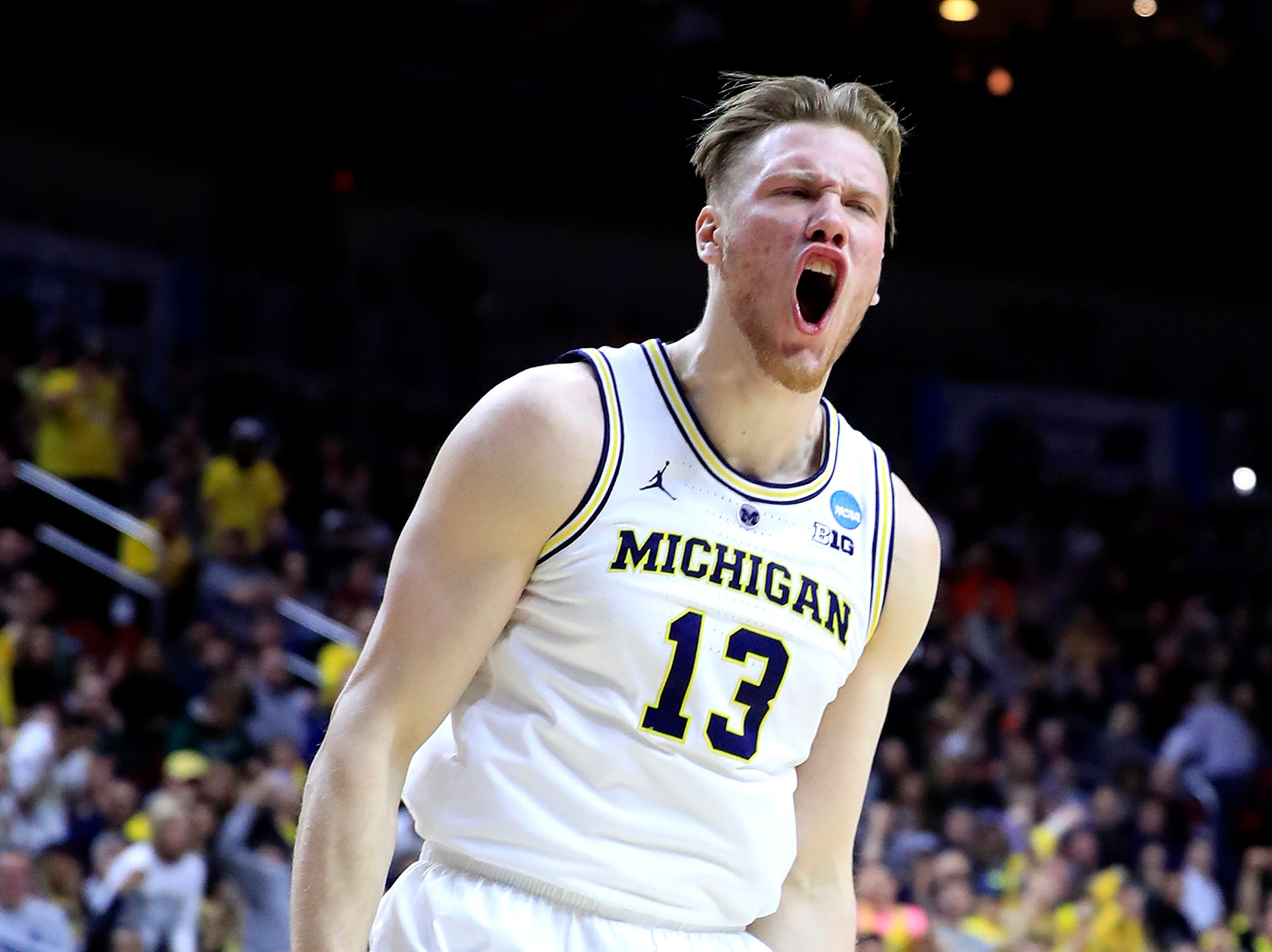 Michigan's Ignas Brazdeikis reacts after a dunk against the Florida Gators during the first half in the second round game of the NCAA tournament at Wells Fargo Arena on March 23, 2019 in Des Moines, Iowa.