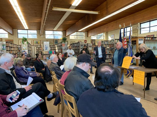 Jerry Goldberg, a UAW retiree and member of the Moratorium Now Coalition, speaks to a crowd at a community meeting about the impact of a GM Detroit/Hamtramck Assembly Plant closure held at the Hamtramck Public Library, Saturday, March 23, 2019.