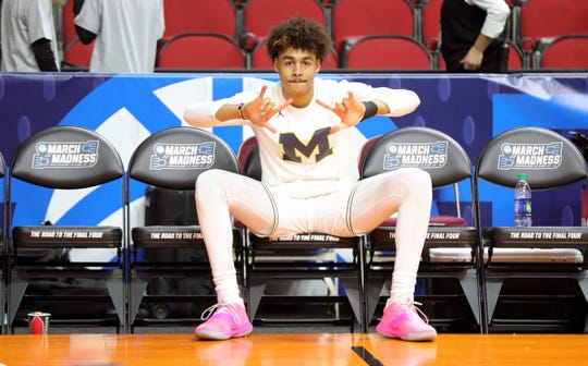 Michigan's Jordan Poole warms up before the second round NCAA tournament game against Florida, Saturday, March 23, 2019 at Wells Fargo Arena in Des Moines, Iowa.