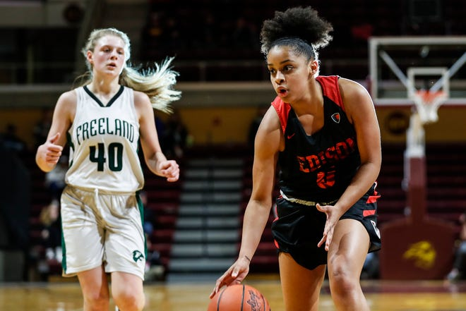 Detroit Edison guard Damiya Hagemann (0) dribbles past Freeland forward Kadyn Blanchard (40) during the first half of MHSAA girls Division 2 final at Van Noord Arena in Grand Rapids, Saturday, March 23, 2019.