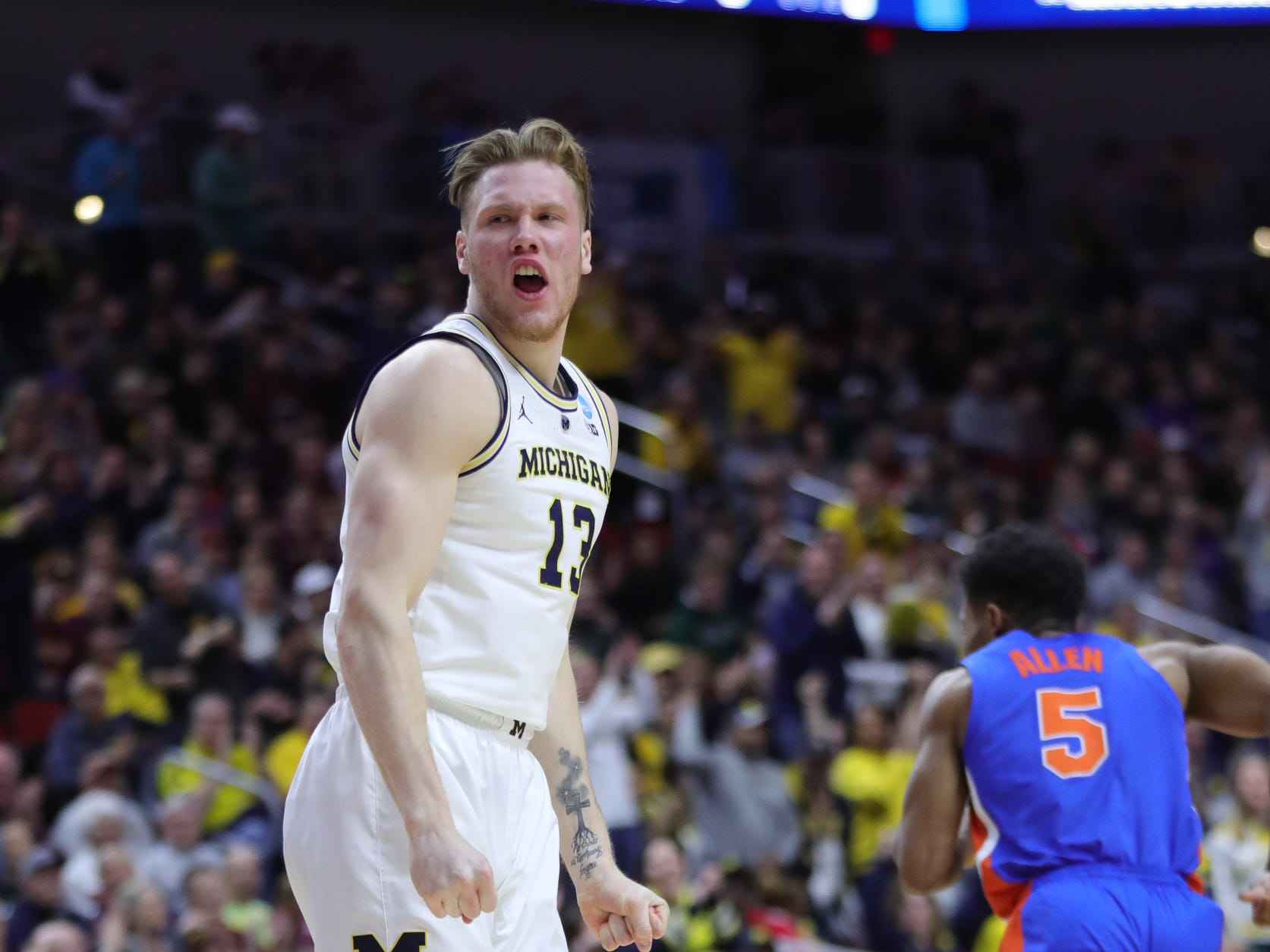 Michigan's Ignas Brazdeikis reacts after a dunk against Florida in the first half of their second round NCAA tournament game Saturday, March 23, 2019 at Wells Fargo Arena in Des Moines, Iowa.
