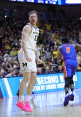 Ignas Brazdeikis reacts after a dunk against Florida on Saturday.