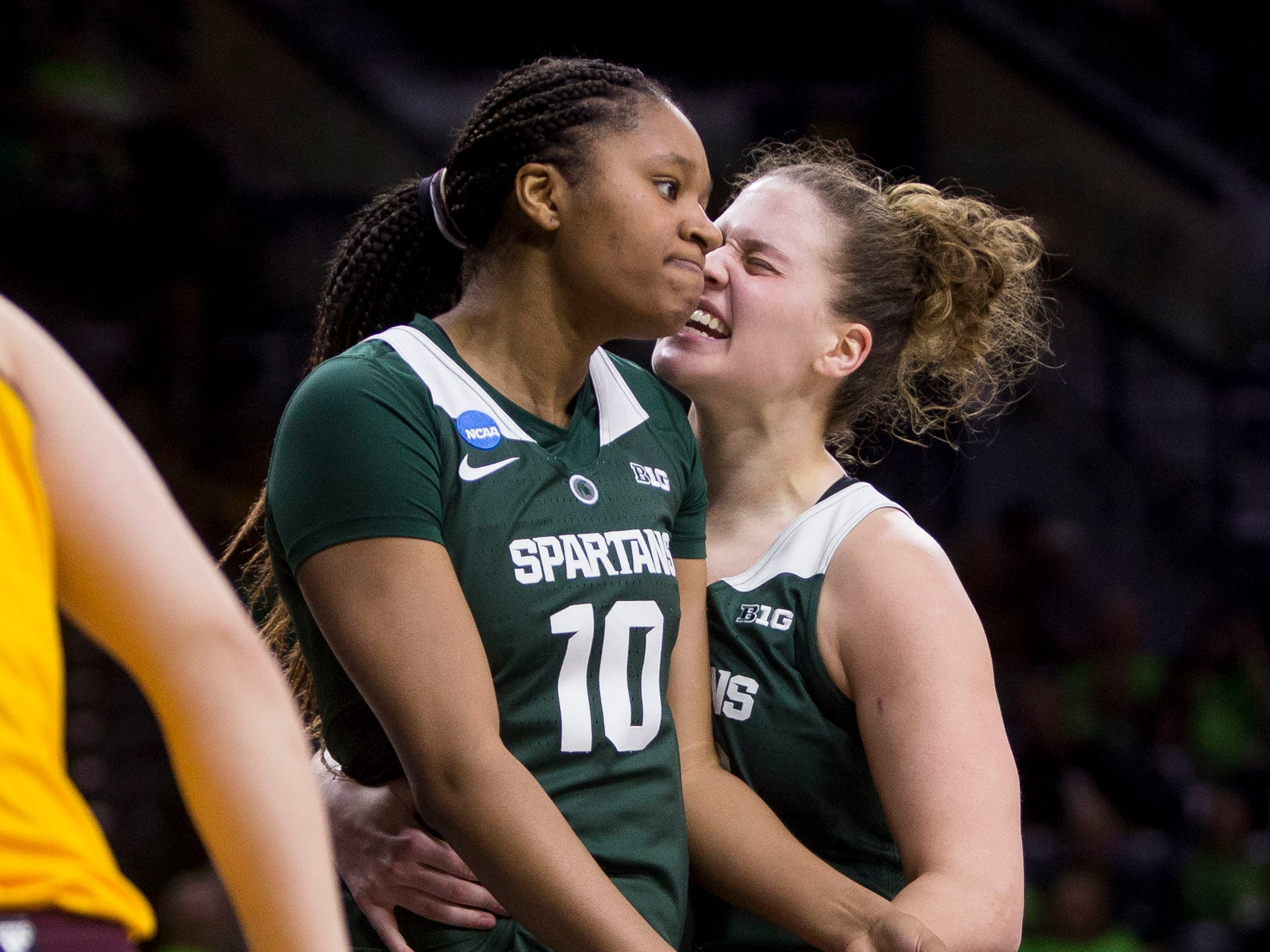 Michigan State's Sidney Cooks (10) and Jenna Allen celebrate next to Central Michigan's Maddy Watters (4) during a first-round game in the NCAA women's college basketball tournament in South Bend, Ind., Saturday, March 23, 2019. Michigan State won 88-87. (AP Photo/Robert Franklin)