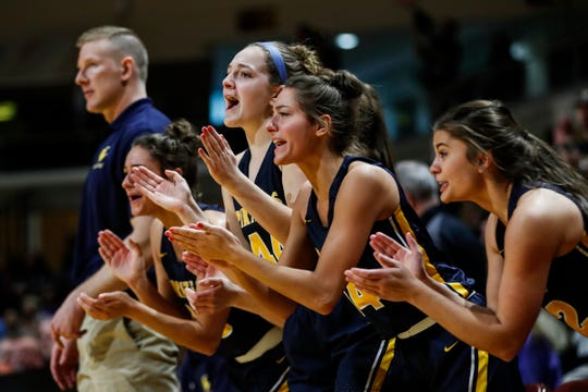 Pewamo-Westphalia bench cheer for the Pirates against Flint Hamady during the first half of MHSAA girls Division 3 final at Van Noord Arena in Grand Rapids, Saturday, March 23, 2019.