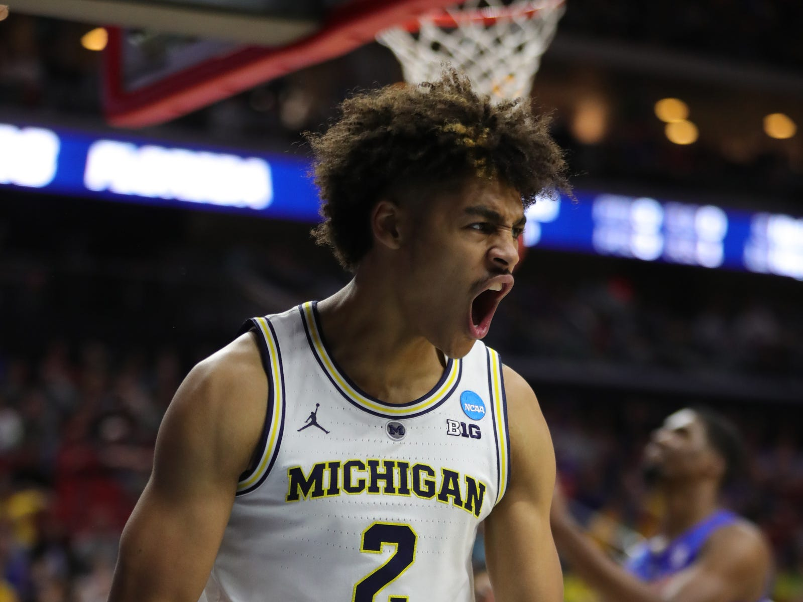Michigan's Jordan Poole reacts after scoring against Florida during the second half of their second round NCAA tournament game Saturday, March 23, 2019 at Wells Fargo Arena in Des Moines, Iowa.