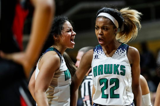 Saginaw Heritage guard Moira Joiner (4) and forward Keyonie Champion (22) celebrate a play against Southfield Arts & Technology during the second half of MHSAA girls Division 1 final at Van Noord Arena in Grand Rapids, Saturday, March 23, 2019.