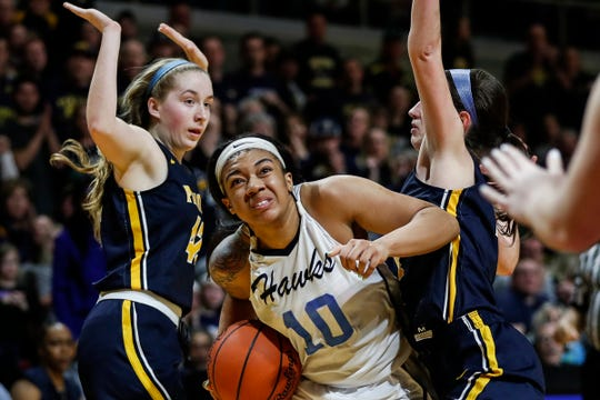 Flint Hamady forward Xeryia Tartt (10) is defended by Pewamo-Westphalia forward Morgan Hengesbach (42) and guard Rachel Huhn (4) during the second half of MHSAA girls Division 3 final at Van Noord Arena in Grand Rapids, Saturday, March 23, 2019.